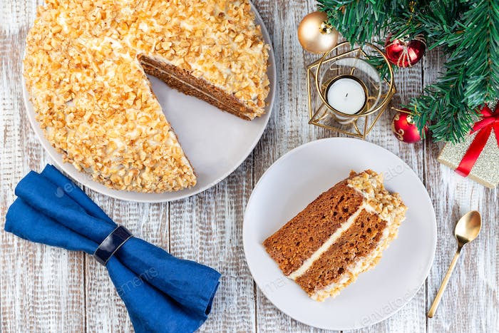 Piece of Carrot cake with cream cheese frosting and walnuts, Christmas decoration