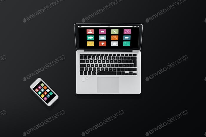 laptop computer with menu icons and smartphone