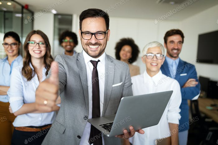 Successful company with happy workers in office