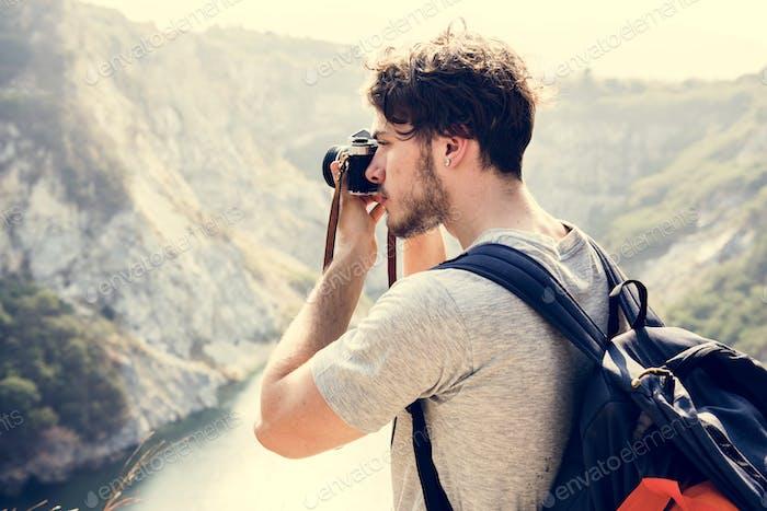 Caucasian man taking photo