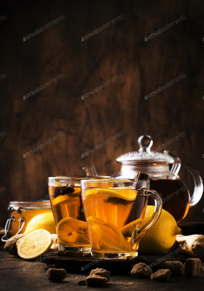 tea with ginger, honey, lemon and spices in glass cup