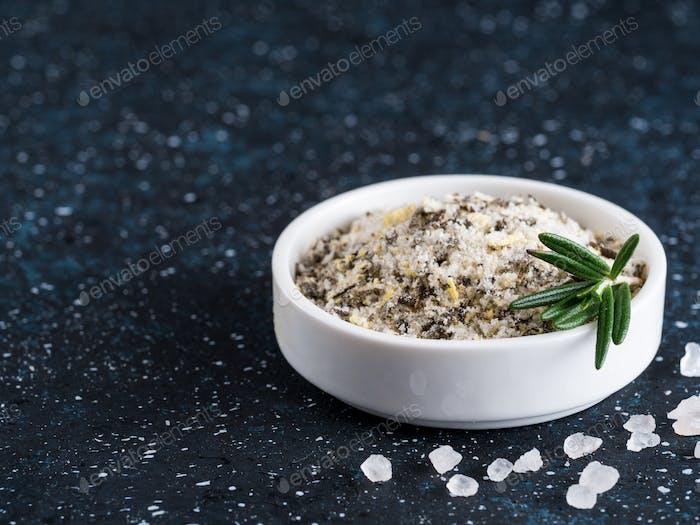 Sea salt scented herb rosemary on dark blue background