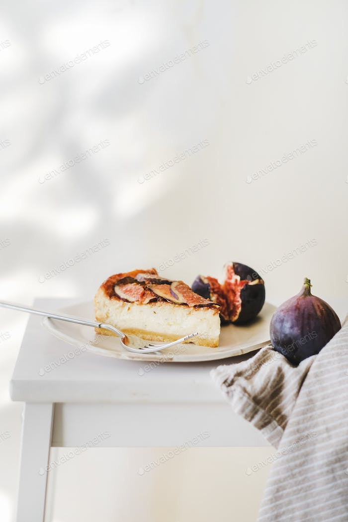 Piece of homemade fig cheesecake with fresh figs on plate
