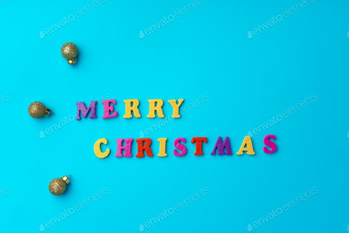 Words Merry Christmas on blue background top view