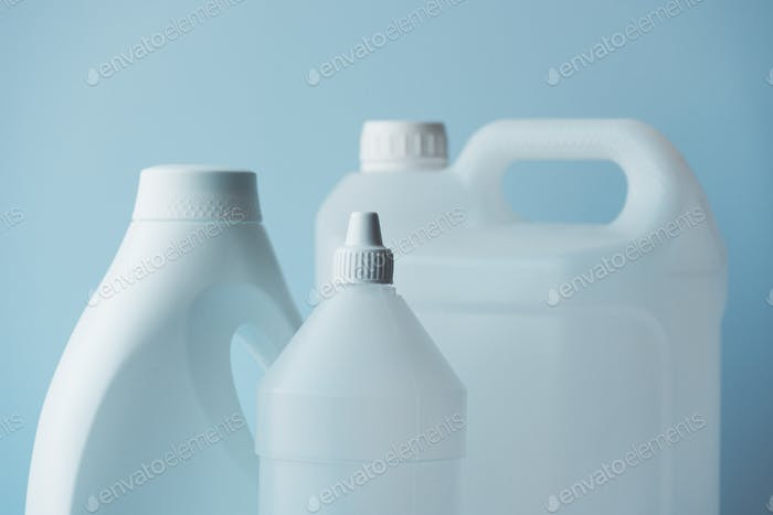 White plastic jerrycan and bottle canister for chemical liquids