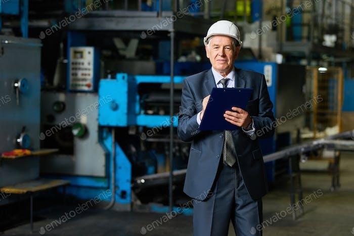 Factory Owner in Workshop