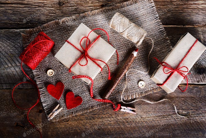Vintage gift boxes with blank gift tag on old wooden background