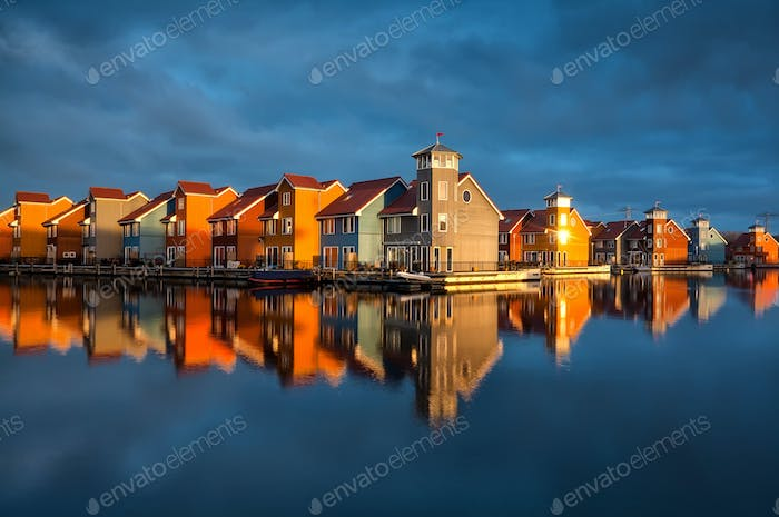 beautiful colorful buildings on water in gold sunshine