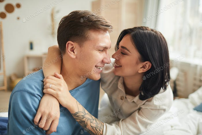 Carefree Couple Embracing in Morning