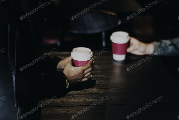 Business partners having take away coffee