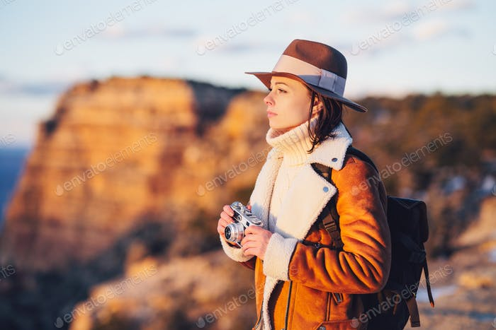 Young photographer with a retro camera in the National Park