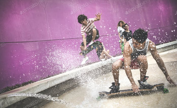 A skateboarder crouching down to skate through water.