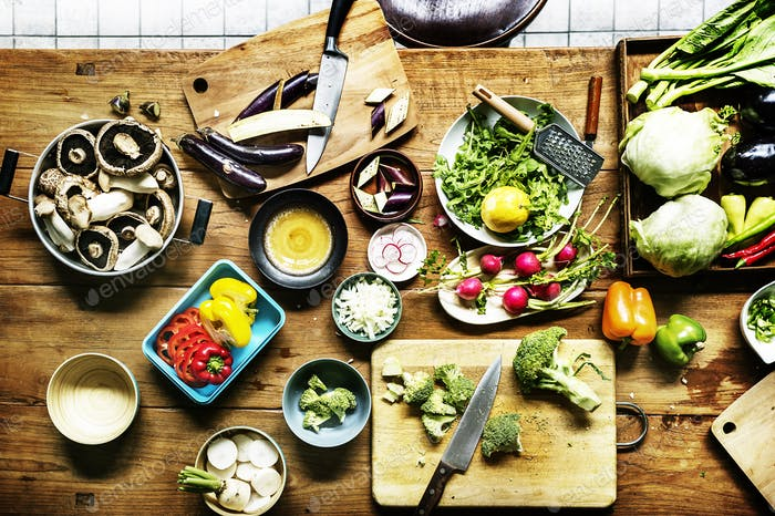 Aerial view of prepare to cook fresh vegetable on wooden table i