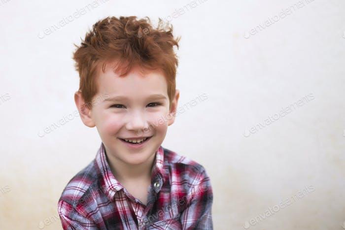 Cute fashionable boy looking at camera