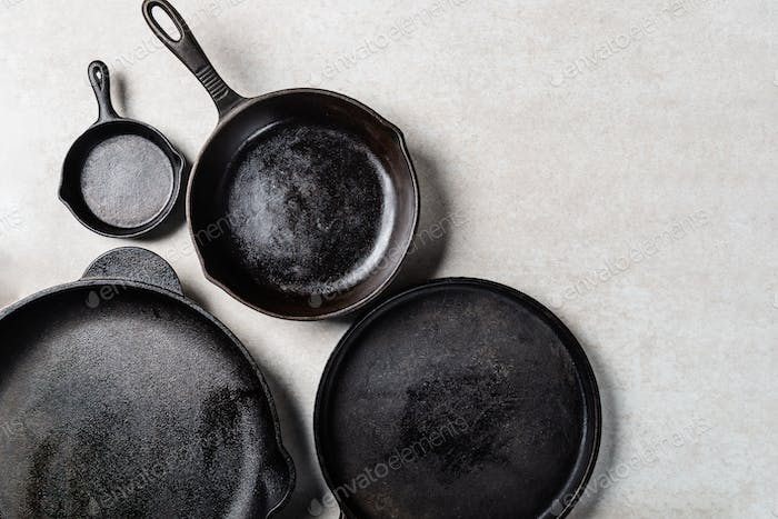 Cast iron Pans or Skillets on Grey Background