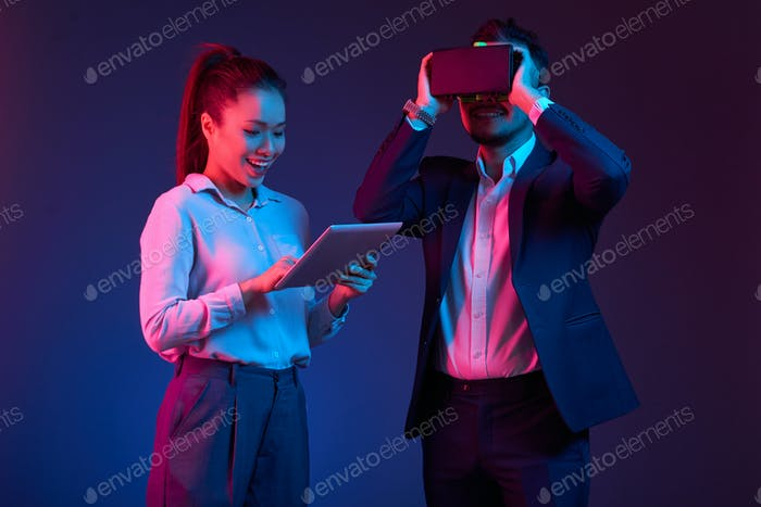 Business people test VR glasses