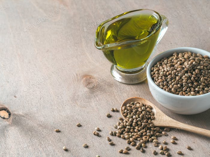 Hemp seeds and hemp oil, copy space