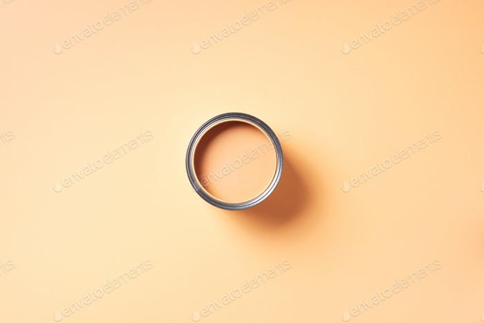 Open paint can with on pastel background. Top view, copy space. Appartment renovation, repair