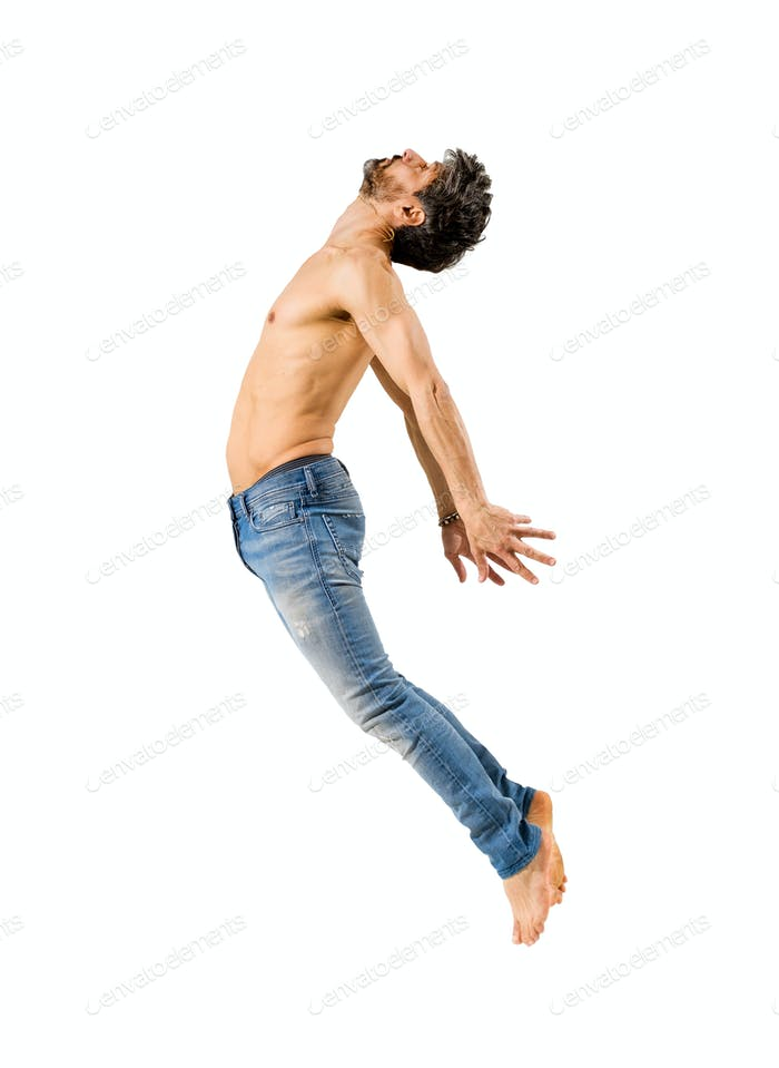 Fit man with bare chest leaping on white background