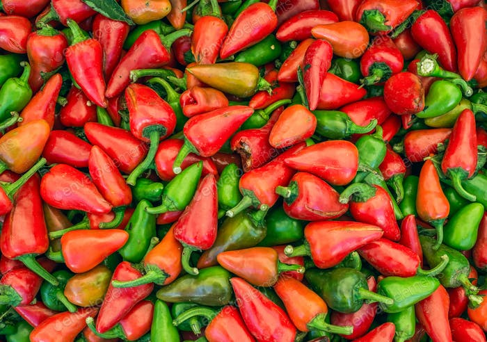 Small green and red paprika on a market stall