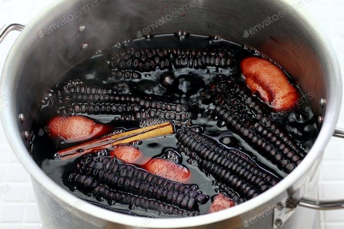 cooking chicha morada, peruvian purple corn drink