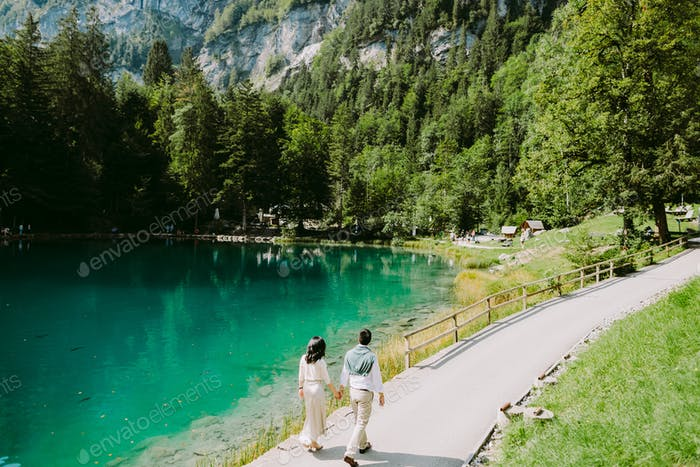 couple travel to mountain lake and forest