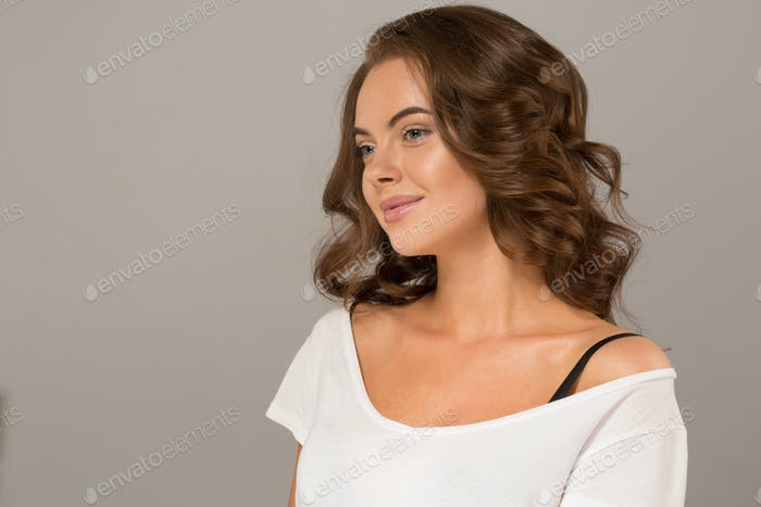 Beautiful hair woman curly long brunette hairstyle healthy skin