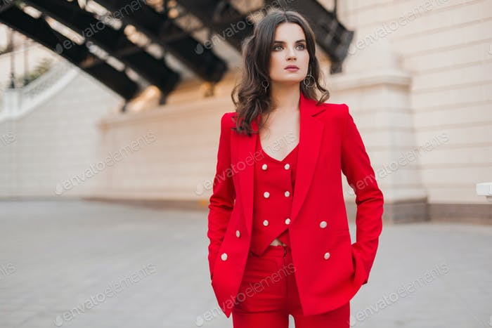 woman in red suit walking in city street, spring summer fashion trend