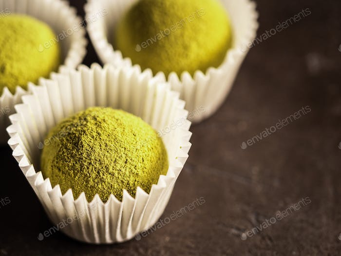 Homemade truffles with matcha tea powder,copyspace