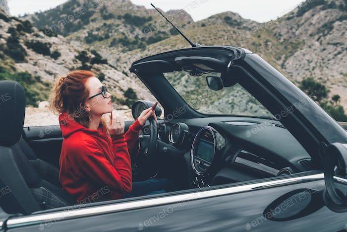 Young woman in cabriolet