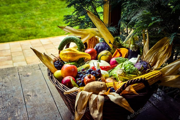 Organic food background. Fruits and vegetables in a basket