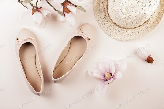 Nude colored ballerina shoes and magnolia flowers