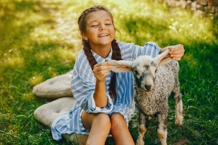 beautiful girl with goat