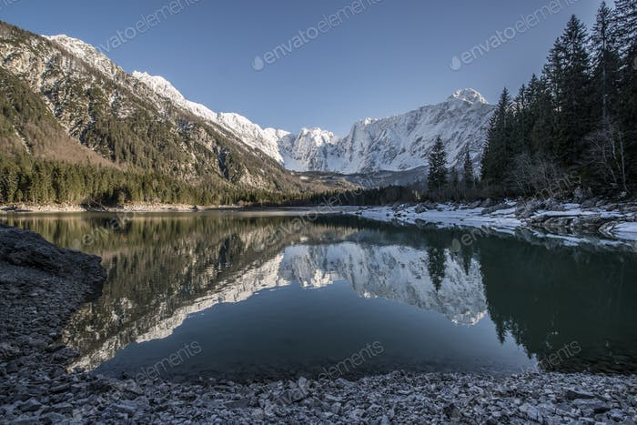 Beautiful reflection of the mountains in the lake Lago di Fusine