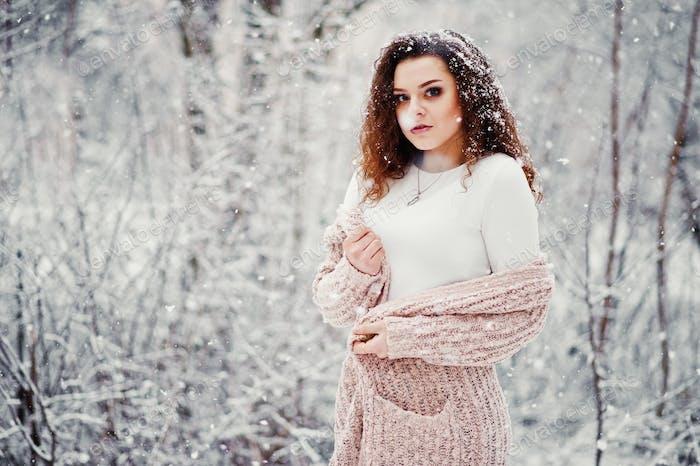 Fashion portrait at snowy weather