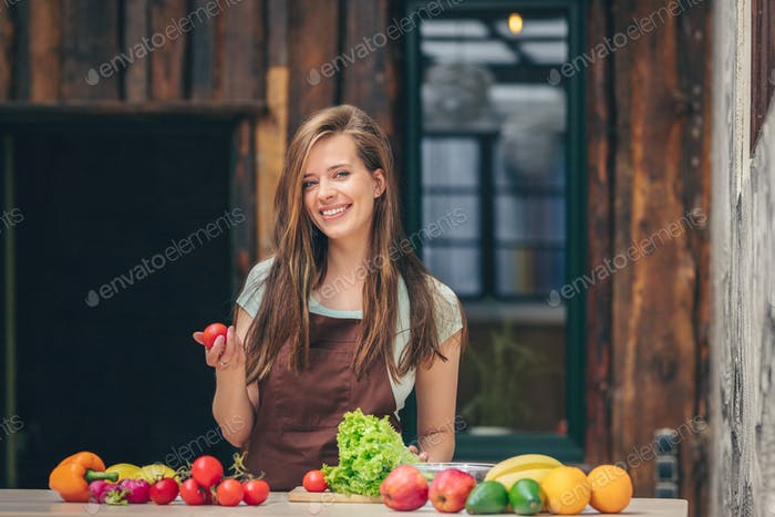 Smiling attractive woman with vegetables