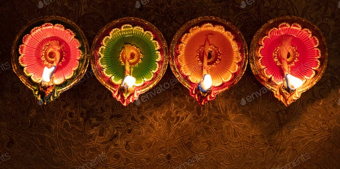 Happy Diwali. Diya colorful oil lamps top view,