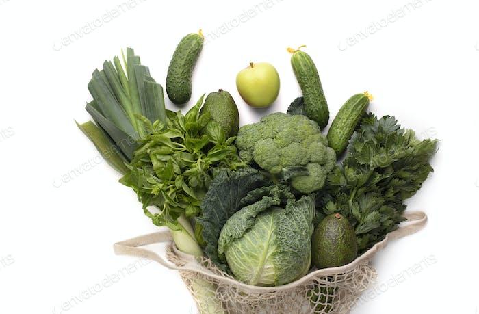 Green bunch of fruits and vegetables inside vintage mesh bag