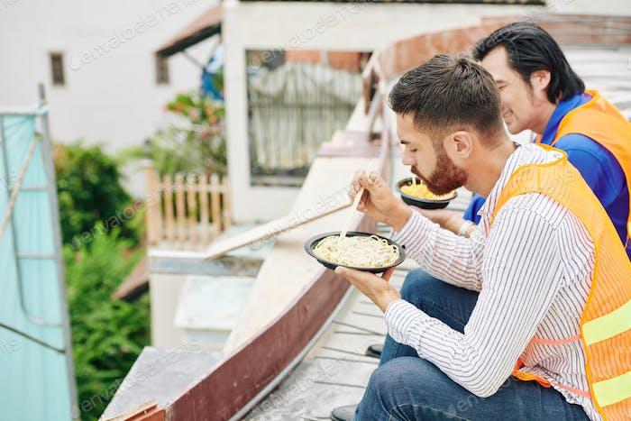 Builders eating lunch