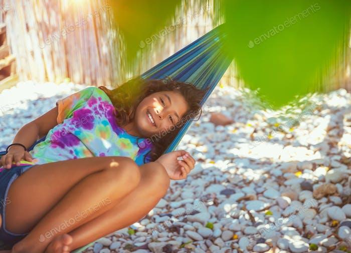 Little girl resting in hammock