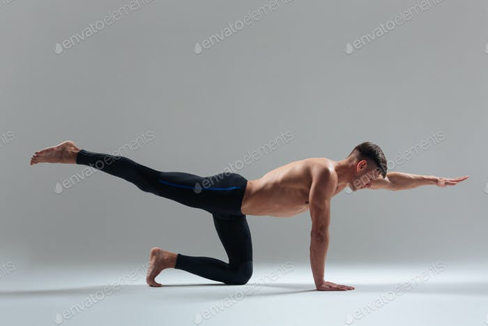 Handsome man doing stretching exercises