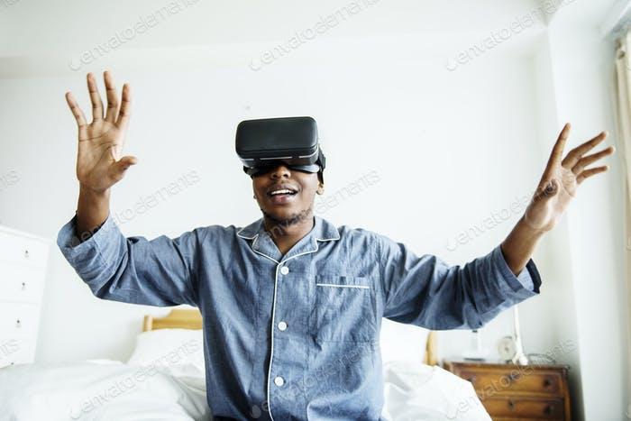 A man experiencing VR in bed