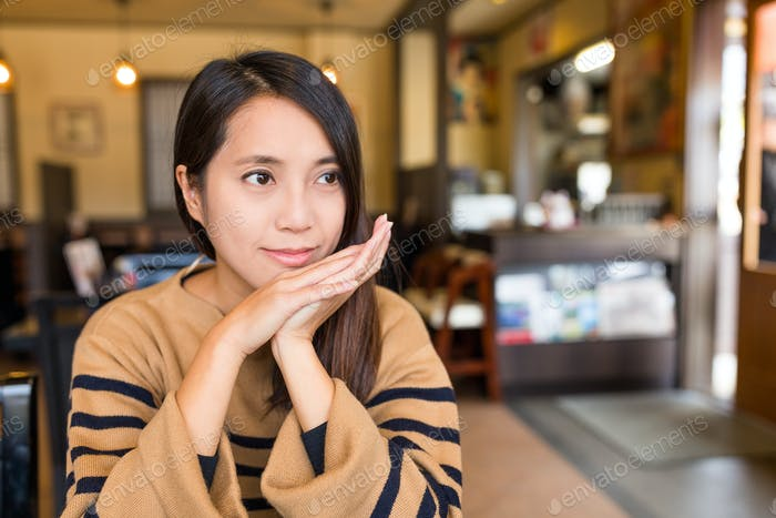 Woman waiting for food in japanese restaurant