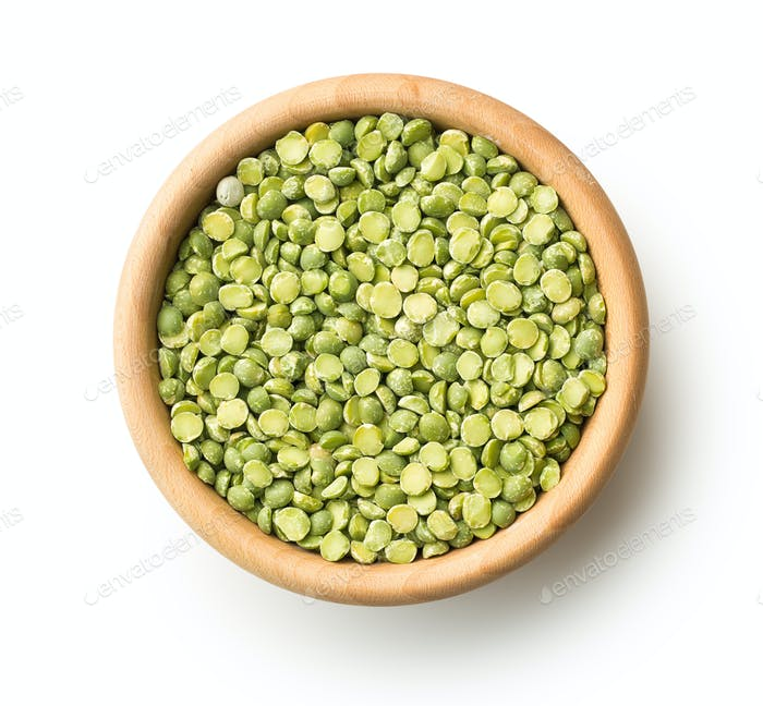 Green split peas in wooden bowl.