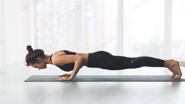 Woman doing plank exercise and push ups