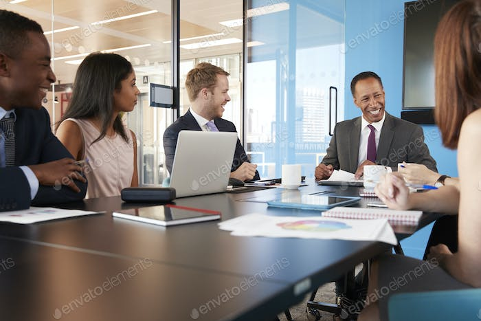 Young professional colleagues at business meeting, close up