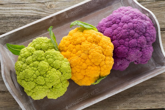 Cauliflower. Rainbow of eco on the wooden table.