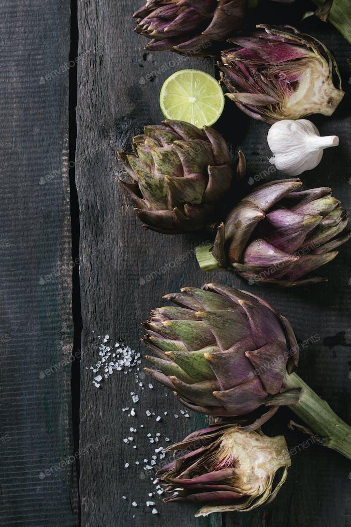 Uncooked purple artichokes