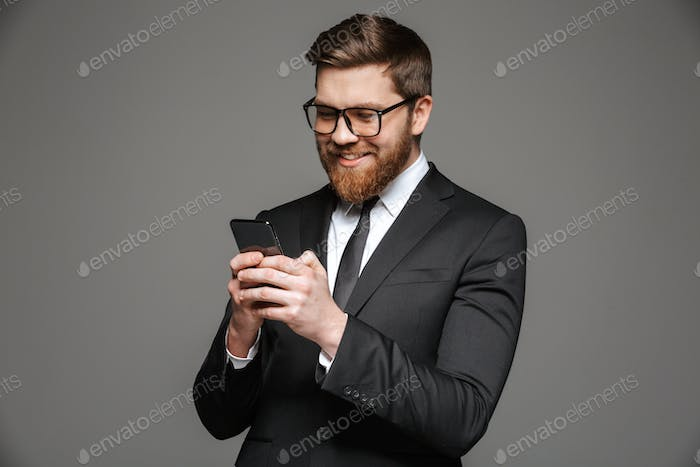 Portrait of a happy young businessman dressed in suit