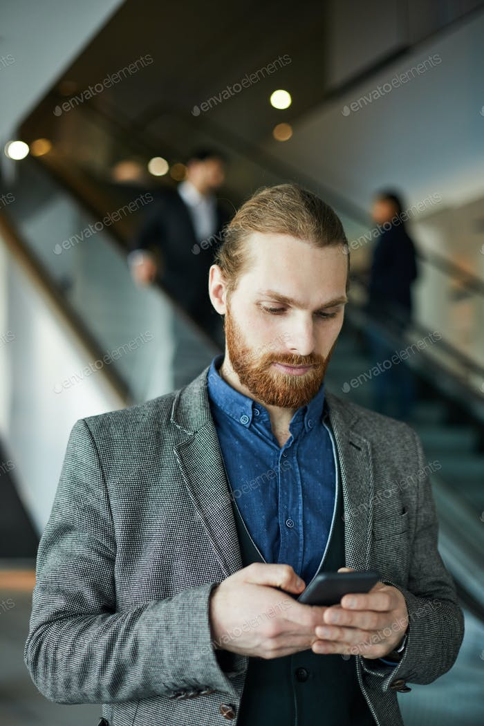Businessman using mobile app on gadget